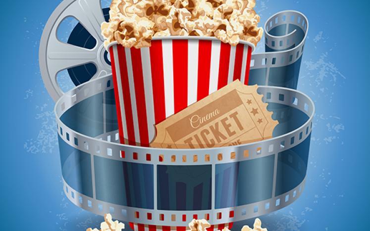 Bucket of popcorn, film reel, and movie ticket